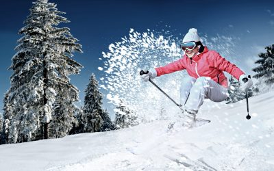 Dynamic picture of a skier on the piste in Alps